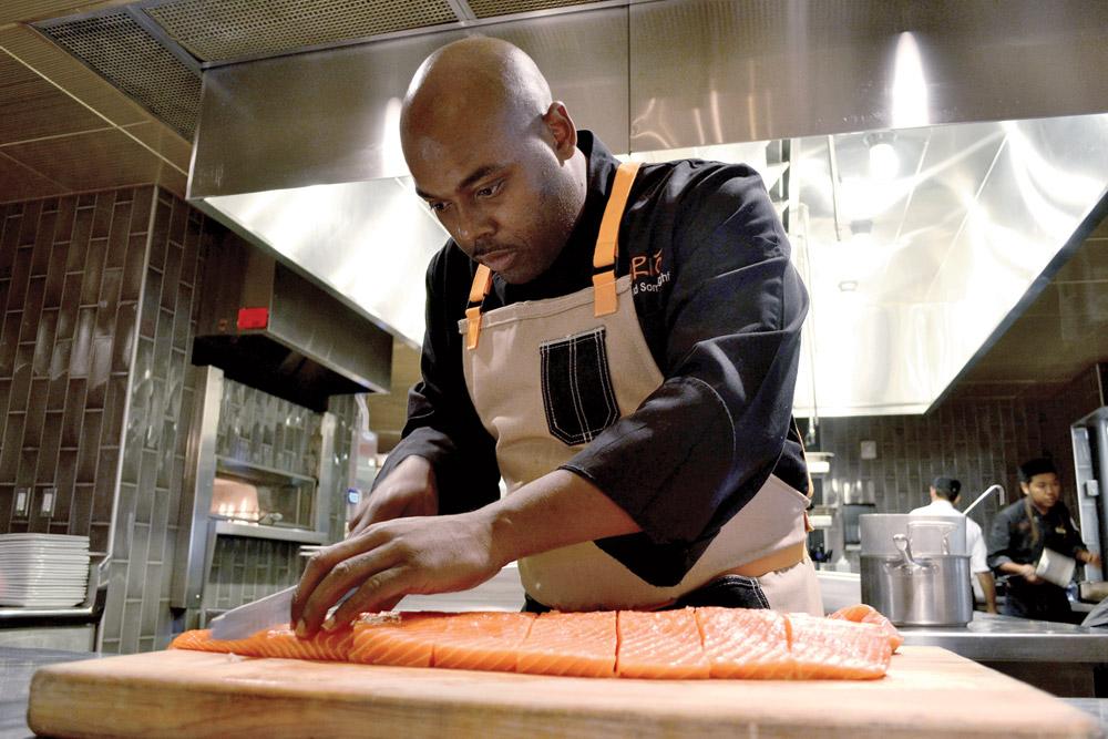 Chef du cuisine Gerald Sombright preparing salmon
