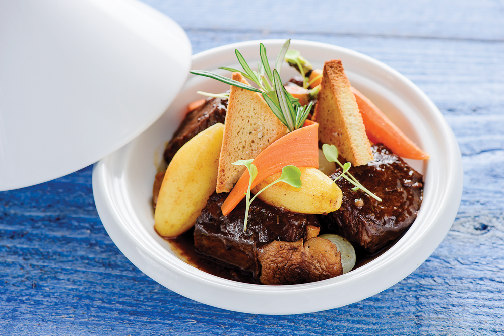 Boneless Wagyu Short Ribs-Braised in a Red Wine Reduction, served with Potatoes, Baby Vegetables and Crustini
